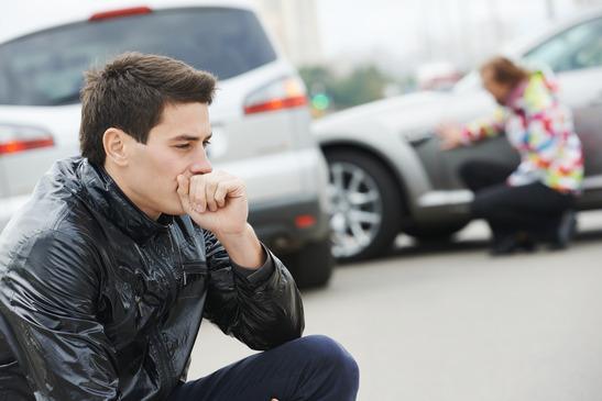 upset man after car accident