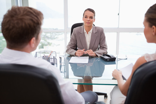 Lawyer Sitting with Couple in Office
