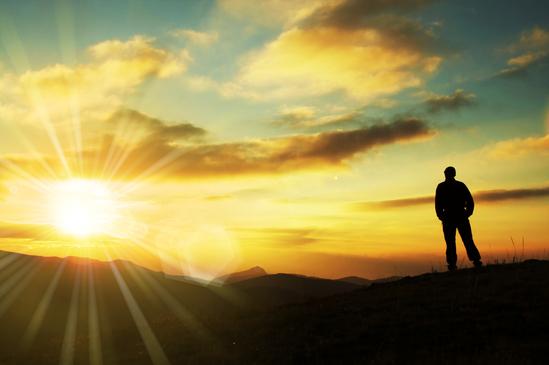 Silhouette Standing on Horizon