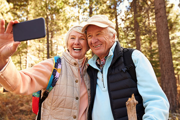 Elderly Man and Woman on Hike