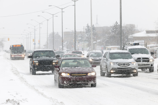 Cars driving during winter snowstorm