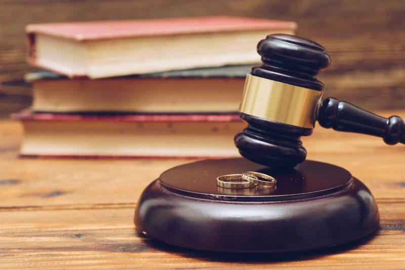 Wooden Judge Gavel And Golden Rings Divorce