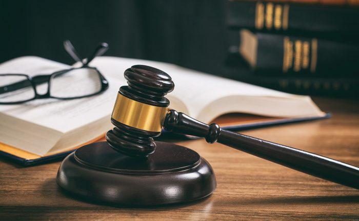 Judge Gavel On A Wooden Desk Law Books Background Pnndslb