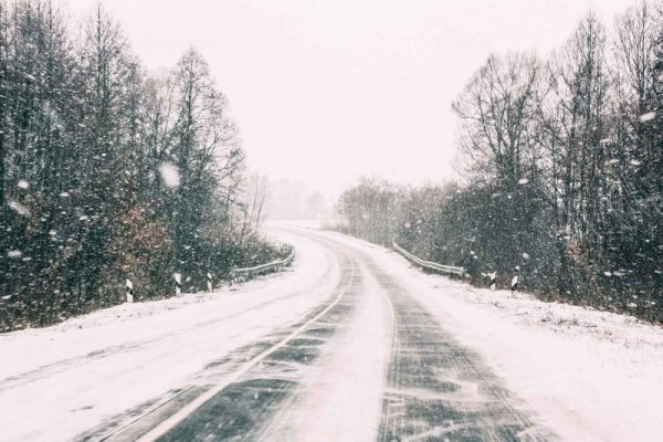 Snow Covered Open Road During A Winter Snowstorm