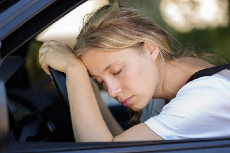 Tired Woman Sleep In Car