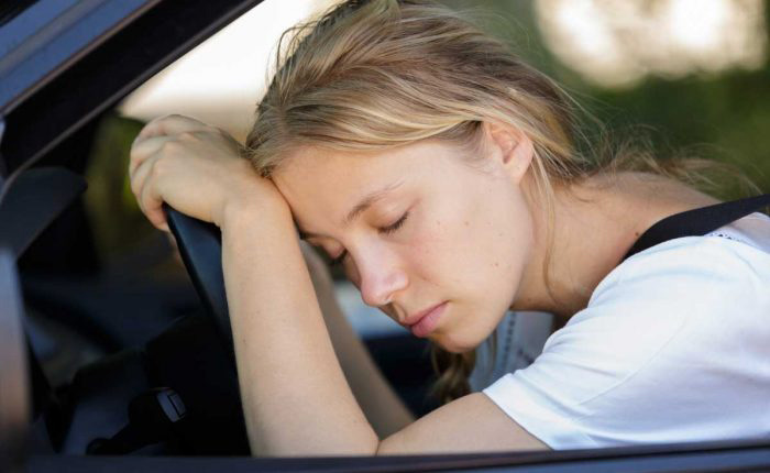 Tired Woman Sleep In Car Puuykmt 700x430