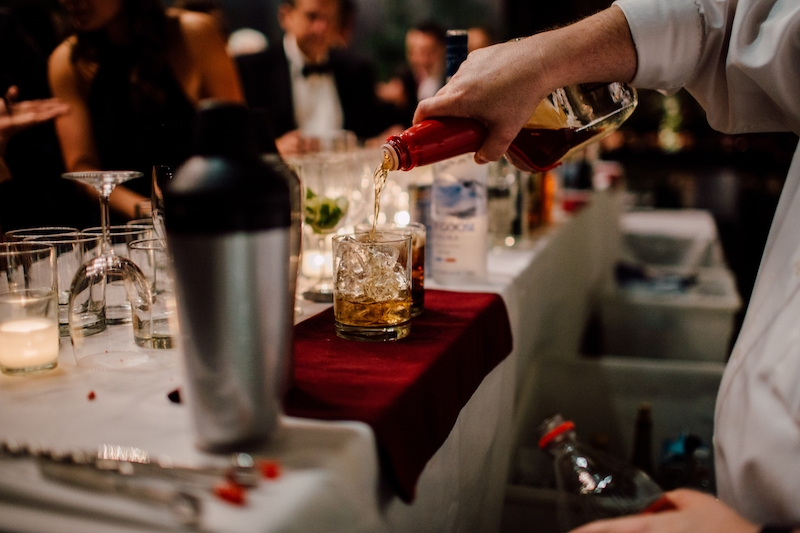 Alcohol being poured at holiday party